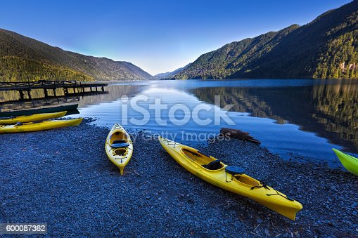 Olympic National Park in Washington State of United States. Water sport of canoes and kayaks at Lake Crescent. The scenic park is located west of the City of Seattle and Tacoma in Washington State. Photographed in horizontal format at predawn sunrise.