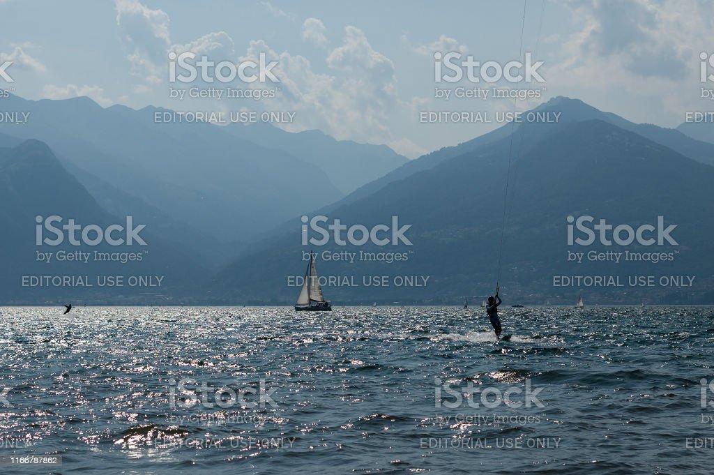 Lake Como, Italy - July 21, 2019. Water sport: kitesurfer surfing the...