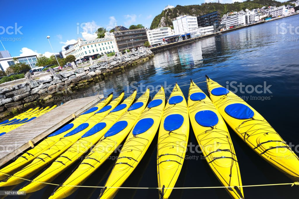 water sports - group of kayaks in alesund, Norway\
