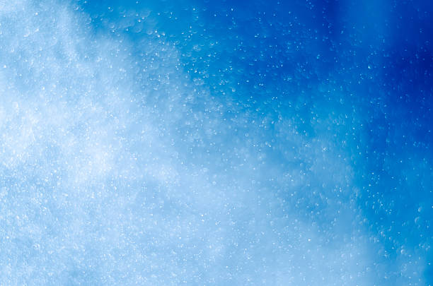 water spray splashing - blue powder stock photos and pictures