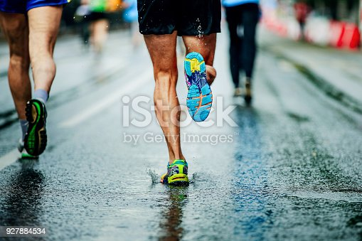 istock water sprays from under running shoes runner men 927884534