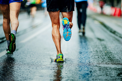 Water Sprays From Under Running Shoes Runner Men Stock Photo - Download Image Now