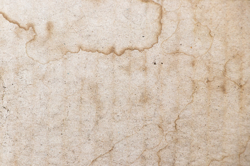 Water stained on brown corrugated packaging material background