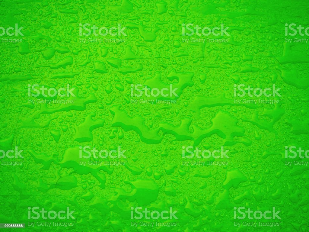 Water stains and drops on wet green surface. Abstract raindrops pattern. Rain in the city stock photo