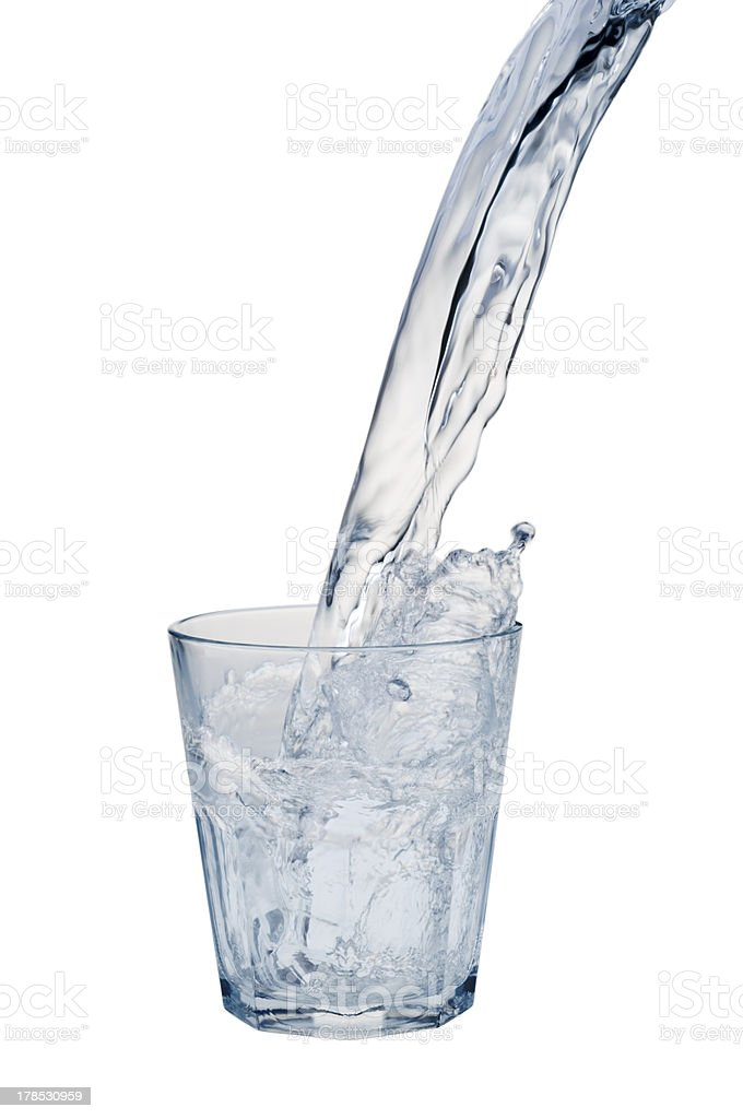 Water stream being poured into a glass royalty-free stock photo