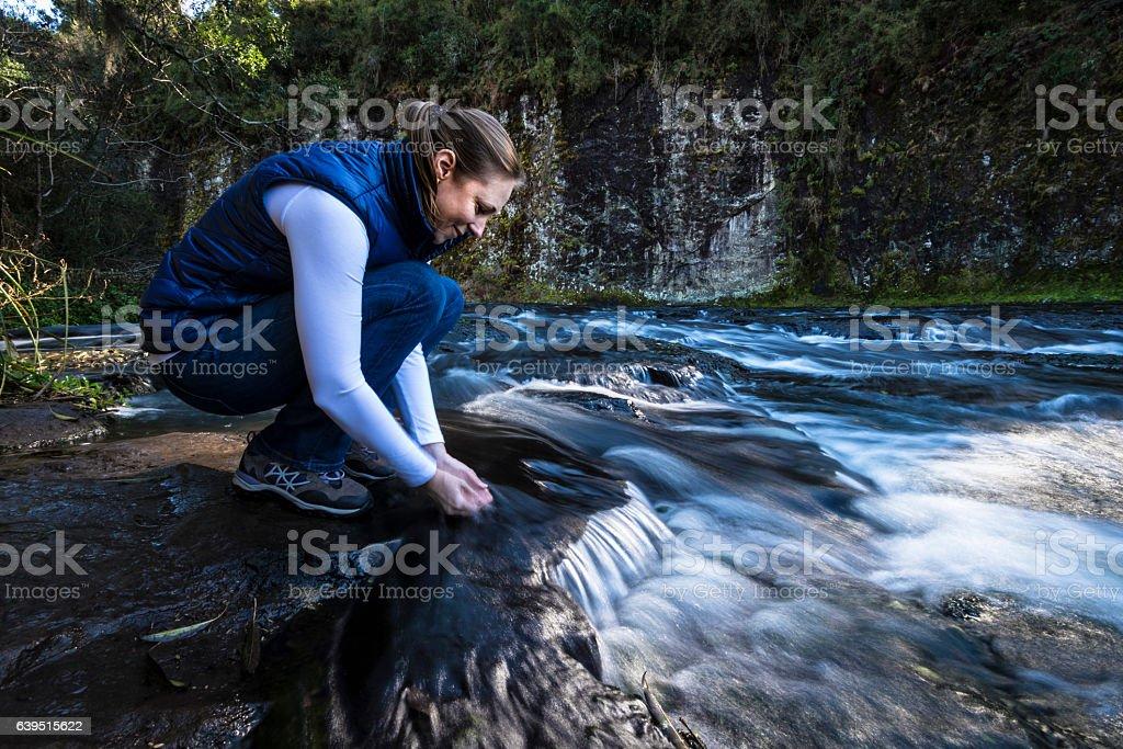 Water stream break stock photo