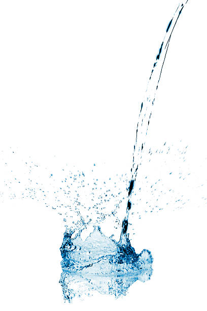 Water stream making a splash when reaching surface stock photo
