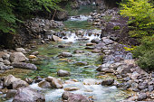 Water stream over stones. Mountain river close up. Water background