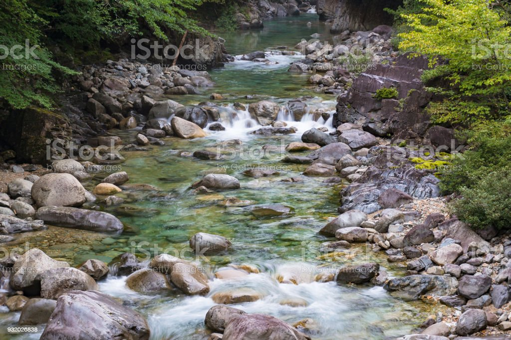 Water stream over stones. Mountain river close up stock photo