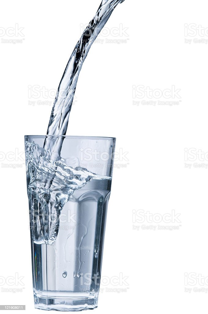 Water stream pouring into a glass royalty-free stock photo