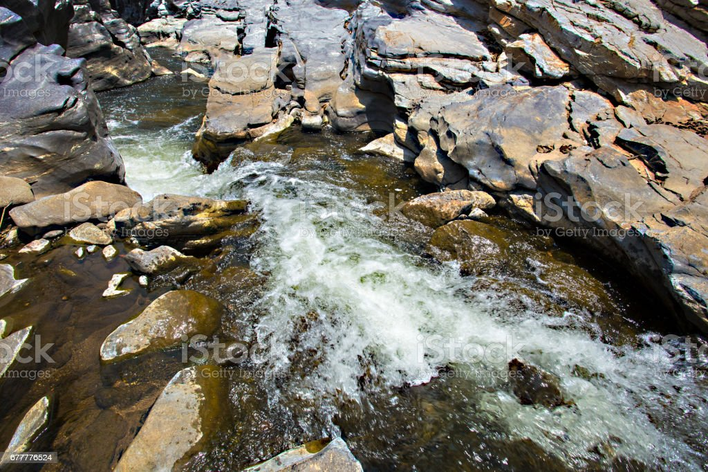 Water stream though the stone stock photo