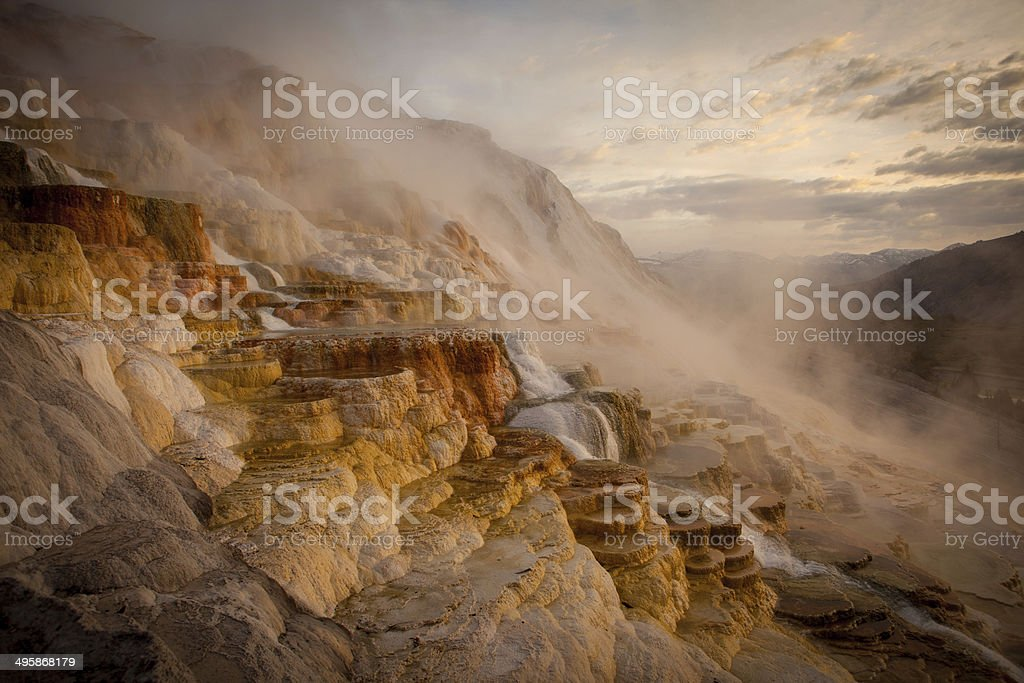 Water streaming down Mammoth Hot Springs before dawn stock photo