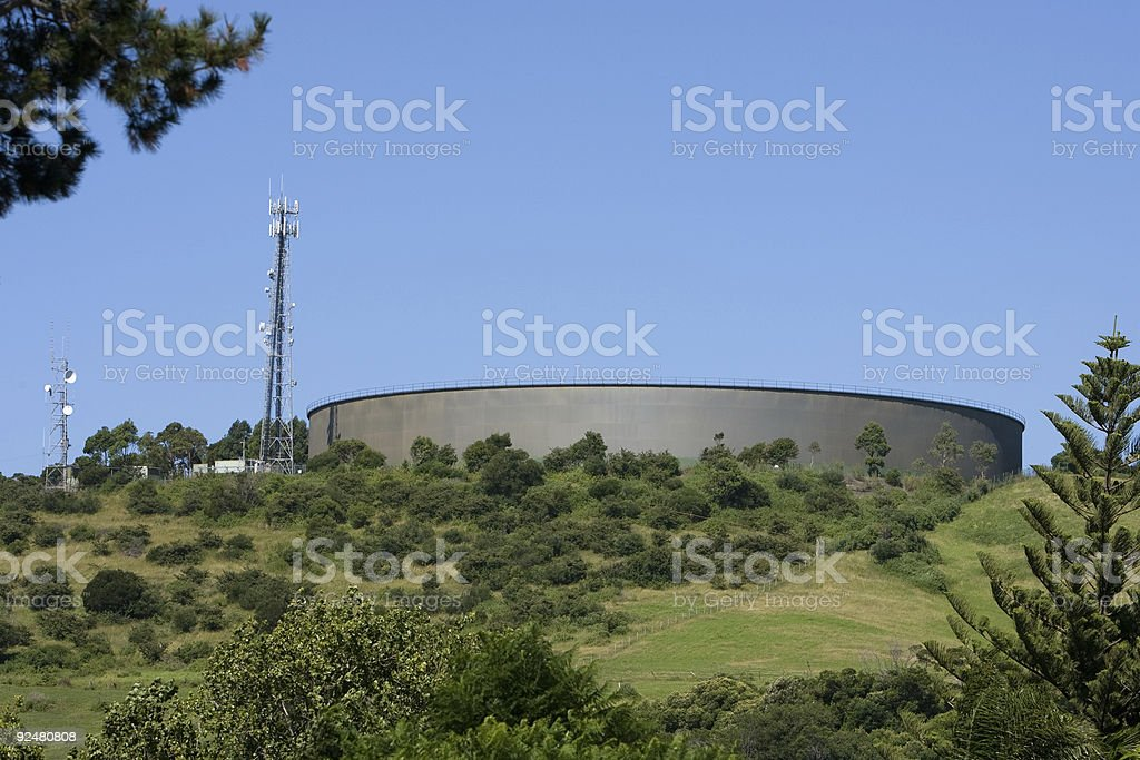 Water supply tank and communications tower royalty-free stock photo