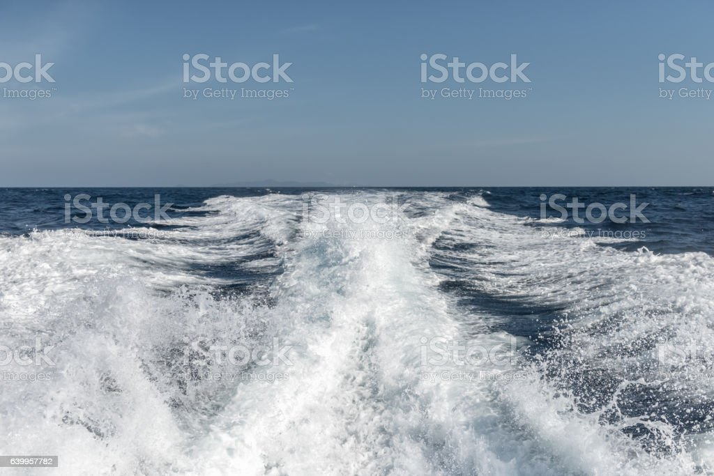 Water surface behind of fast moving motor boat stock photo