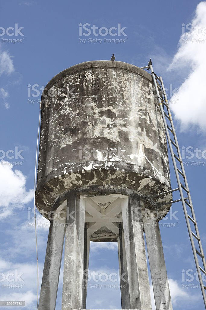 Water Tank Elevated Over A Mortar Structure Stock Photo