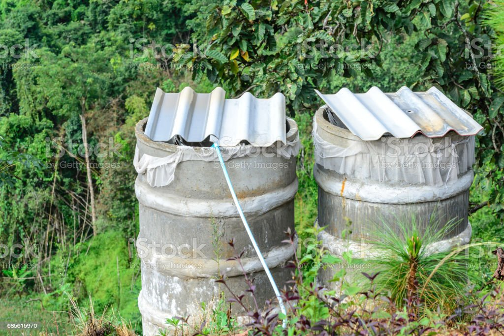 Water tank for plumbing system from cataract in forest. royalty-free 스톡 사진