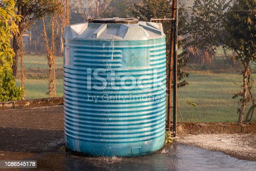 istock Water tank overflowing, fitted in house 1086545178