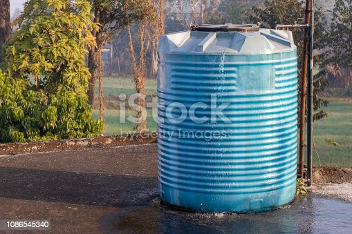 istock Water tank overflowing, fitted in house 1086545340