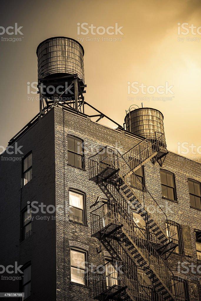 Water Tanks on Brick Brooklyn Building (Sepia Tone) stock photo
