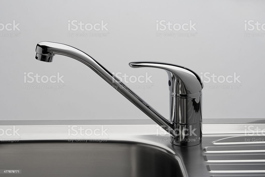 Water tap and sink in a modern kitchen. royalty-free stock photo