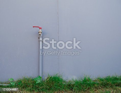 Water tap, old water tap next to the wall