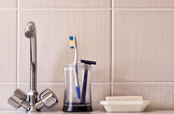 Water taps Toothbrush Razor stock photo