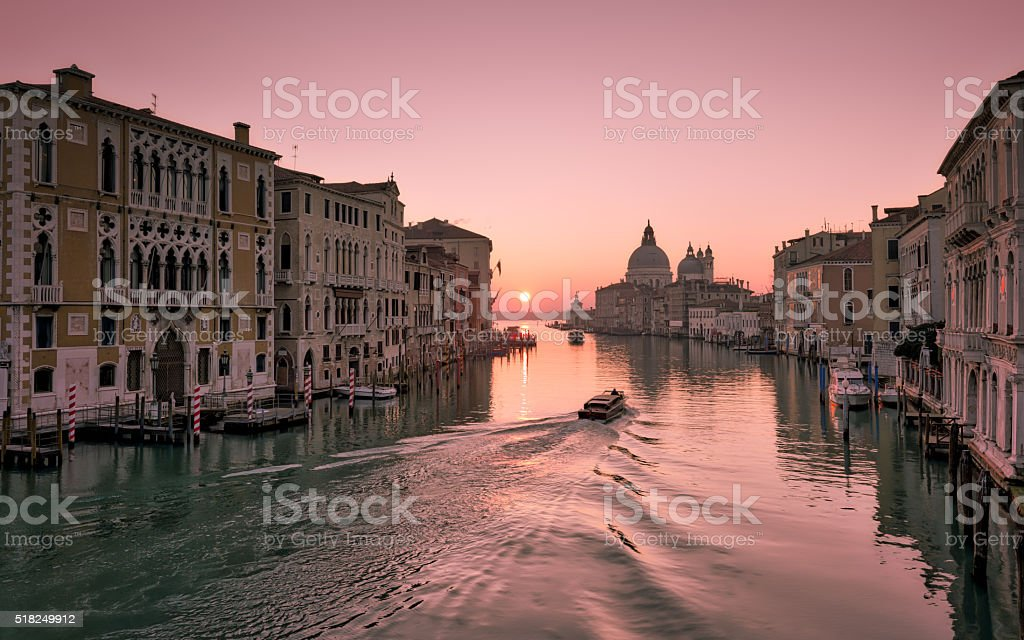 Water taxi at sunrise on Grand Canal in Venice stock photo