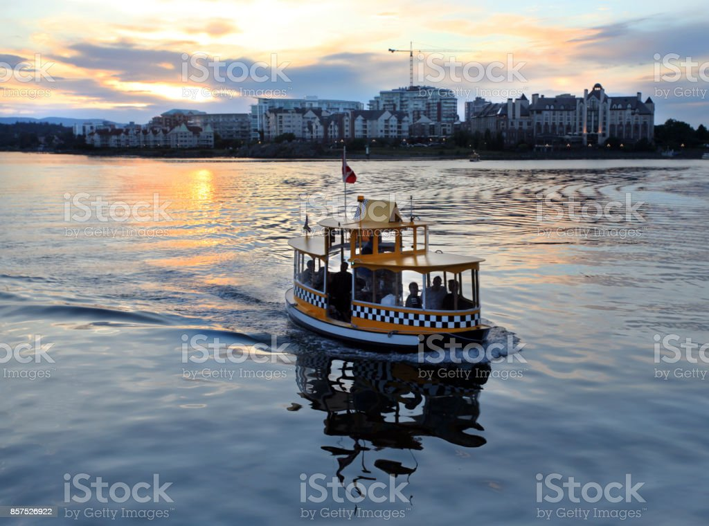Water taxi at sunset.  Victoria Harbor, British Columbia, Canada. stock photo