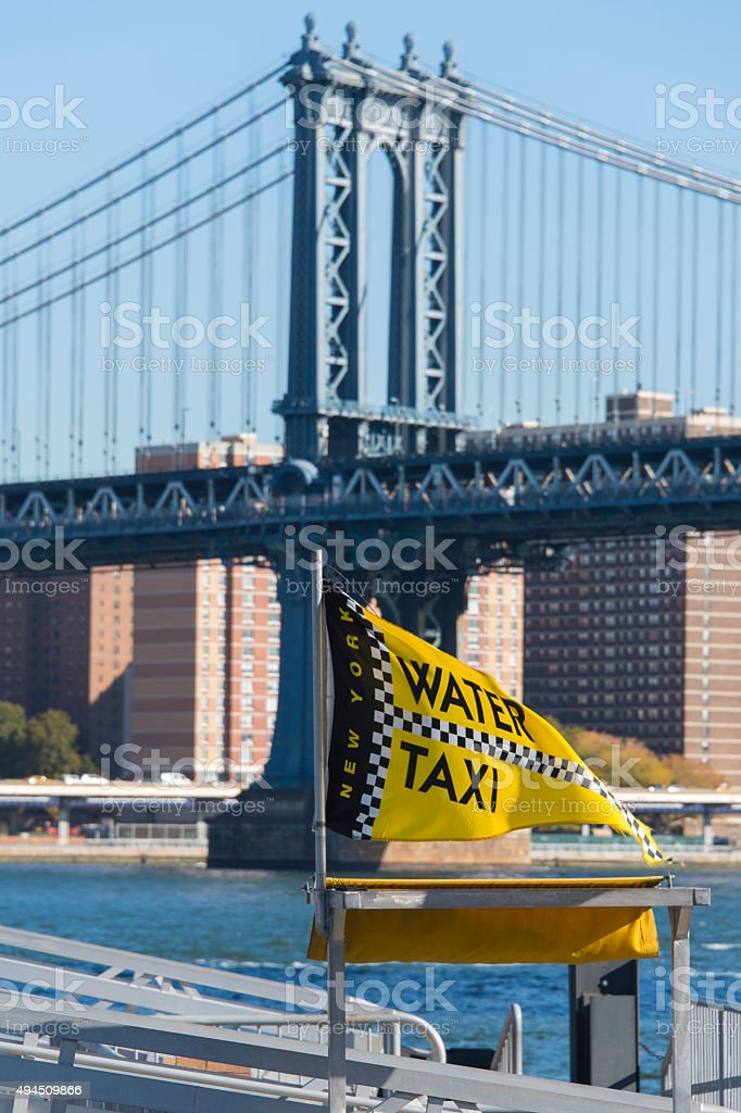 Water taxi flag with the Manhattan Bridge in the background stock photo