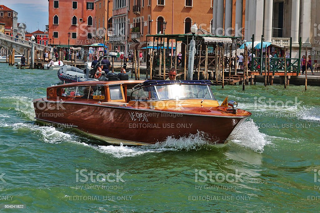 Water taxi with passengers in Venice, Italy stock photo
