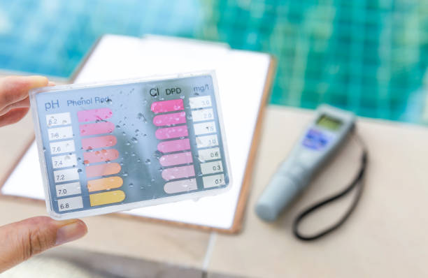 Water test kit over blurred background of digital water tester and paper clipboard stock photo