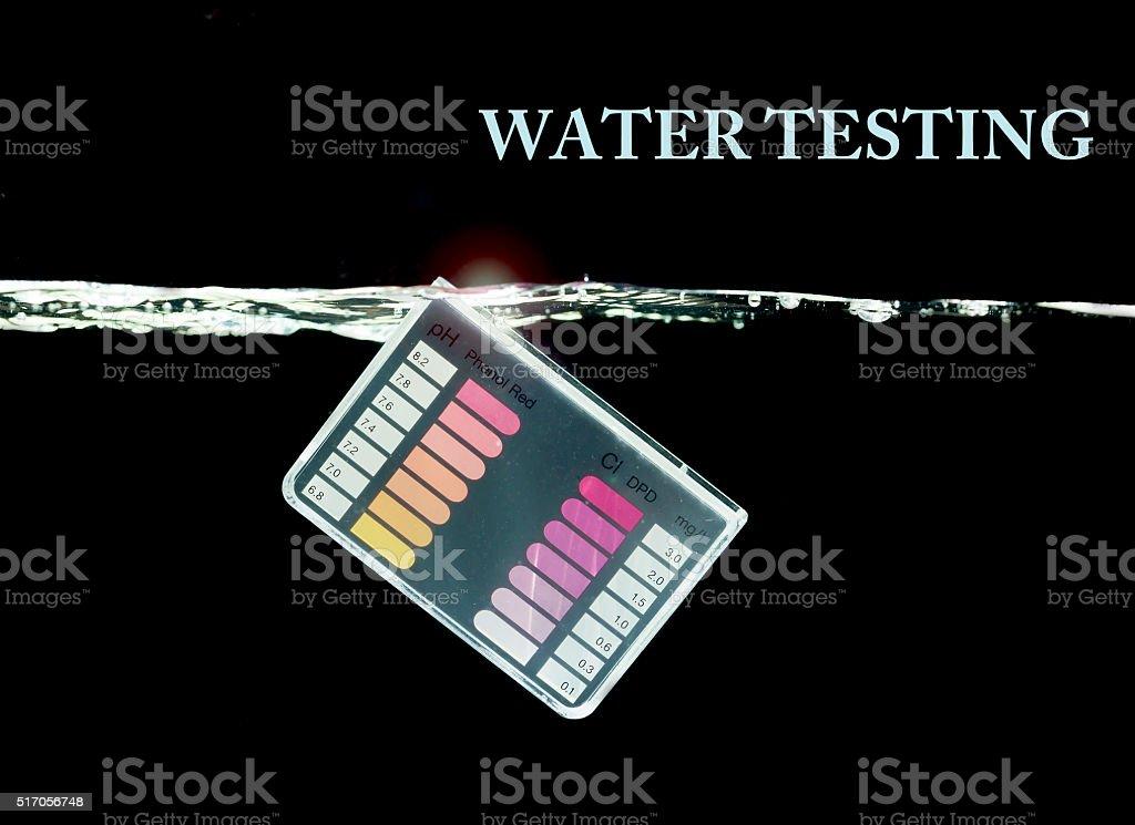 Water testing kit on black background stock photo