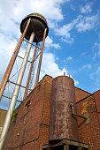 Old water tower and iron boiler essentially an old water heater and heating system dated from turn of the century in downtown Detroit, MI