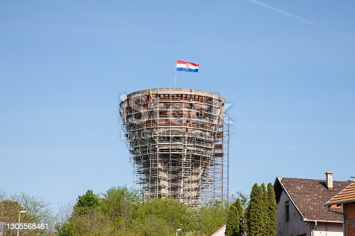 Picture of a croatian flag over the Water Tower in Vukovar, Croatia, also called vukovarski vodotoranj. During the Battle of Vukovar in 1991, the Water Tower was one of the most frequent targets of artillery and hit more than 600 times