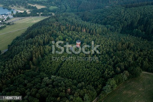 Water tower in the woods - aerial view