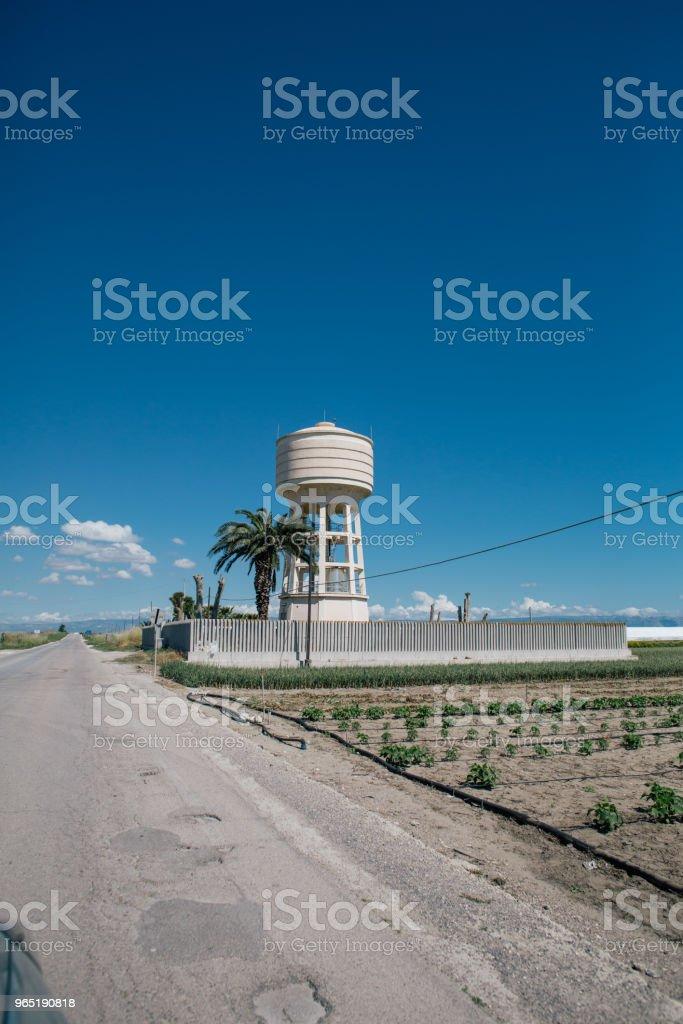 Water tower near the road in Apulia Italy zbiór zdjęć royalty-free