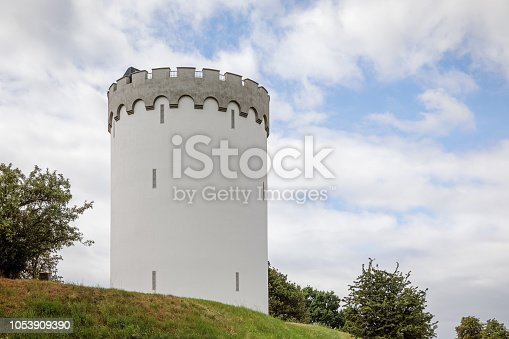 Fredericia is af fortification in Jutland (Denmark)  from 1650 build to prevent the Germans to cross over to the Island of Fuen. In 1909 when the fortification was obsolete, there where build a water tower in a style which fitted the surroundings.