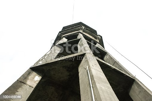 Full frame photo of an old water tower shooted directly from below.