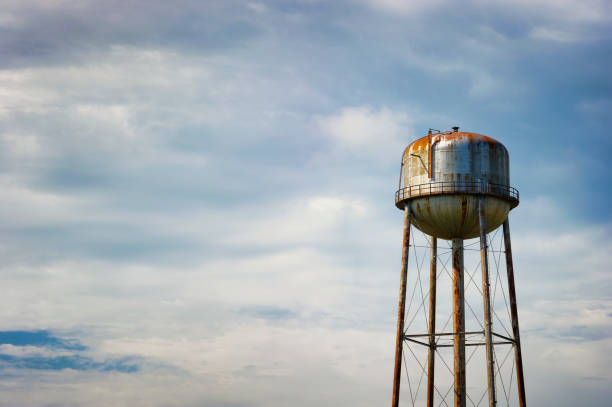 Water tower under cloudy skies stock photo