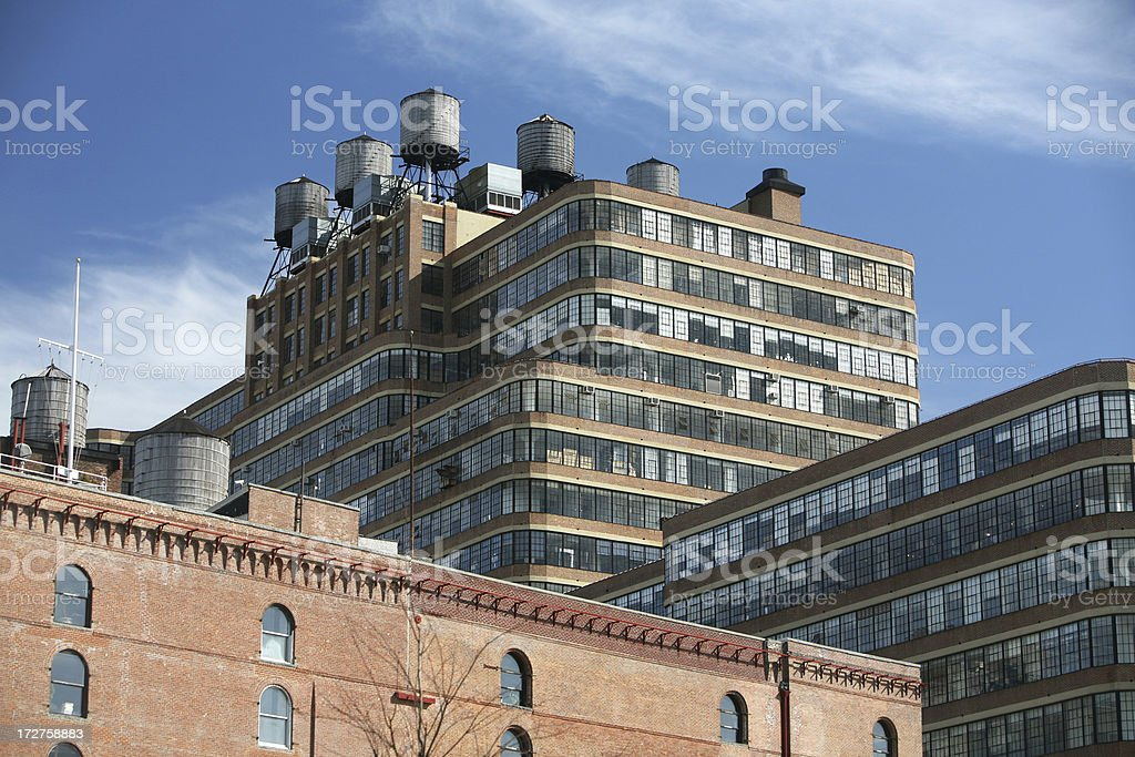 Water Towers On Warehouse Rooftop royalty-free stock photo