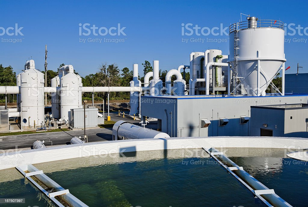 Water Treatment Facility with Water Tank in Foreground stock photo