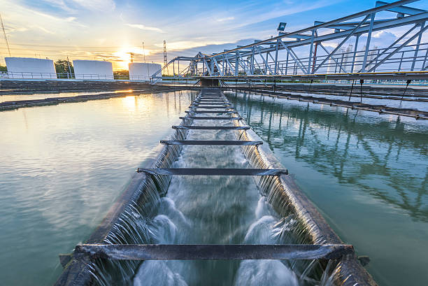 Water Treatment Plant at sunset Water Treatment Plant process at sunset sewage treatment plant stock pictures, royalty-free photos & images