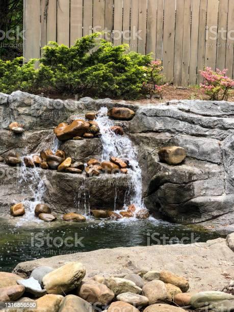 Photo of Water trickling down rocks