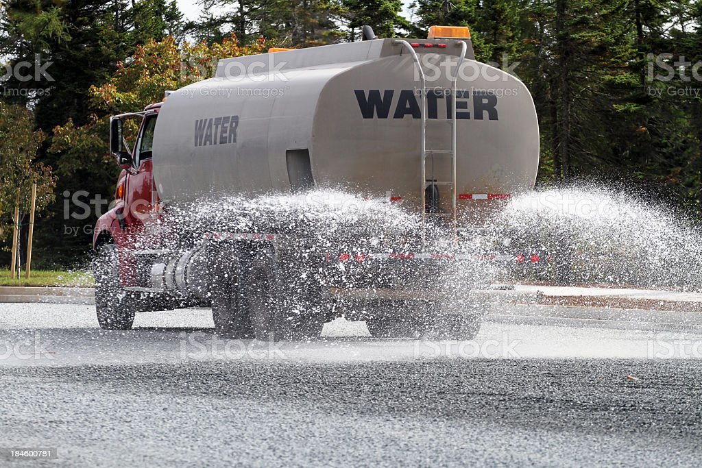 A Water truck spraying the street royalty-free stock photo