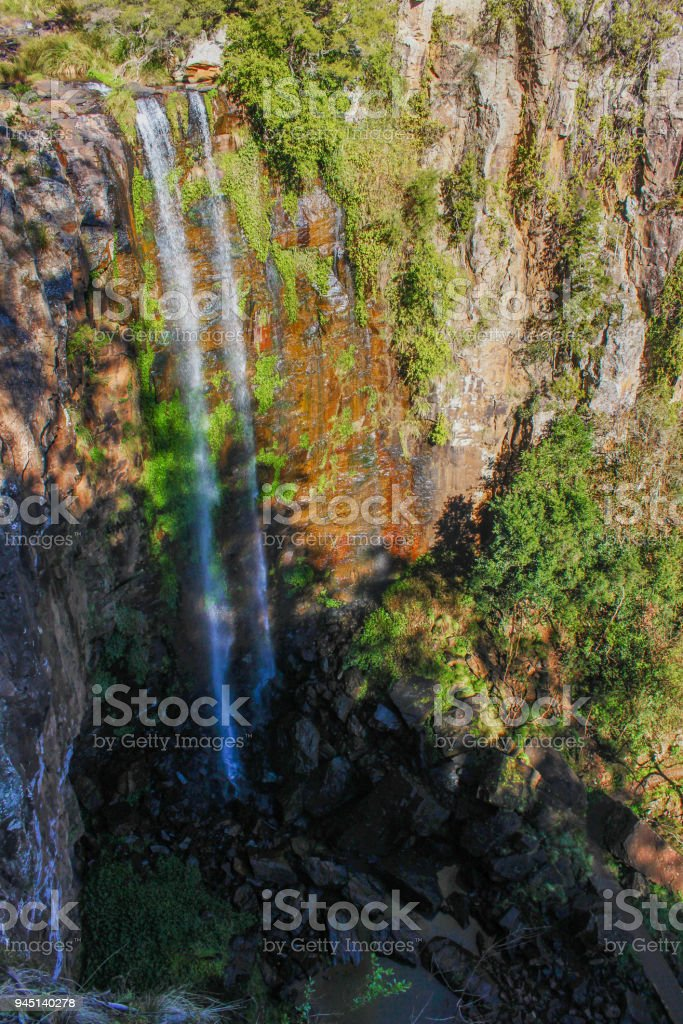 Water tumbles 40 meters down a cliff onto the rocks below at the Queen Mary Falls near Killarney Queensland Australia stock photo