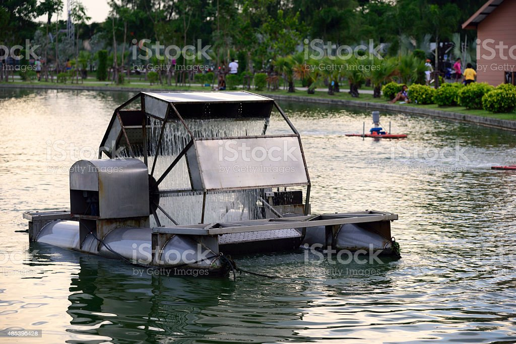 water turbine aeration in the pond stock photo