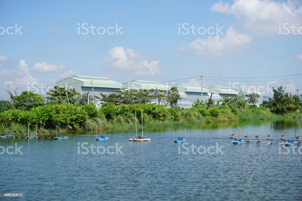 water turbine in the pond stock photo