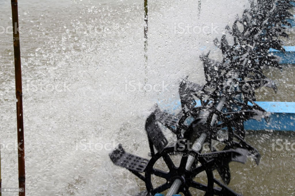 Water turbine Rotate in a pond of aquatic animals. stock photo