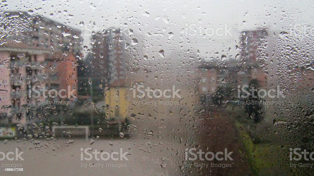 Water vapour on glass window in town stock photo