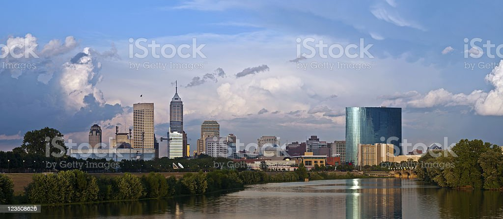 Water view of Indianapolis city skyline under cloudy sky stock photo